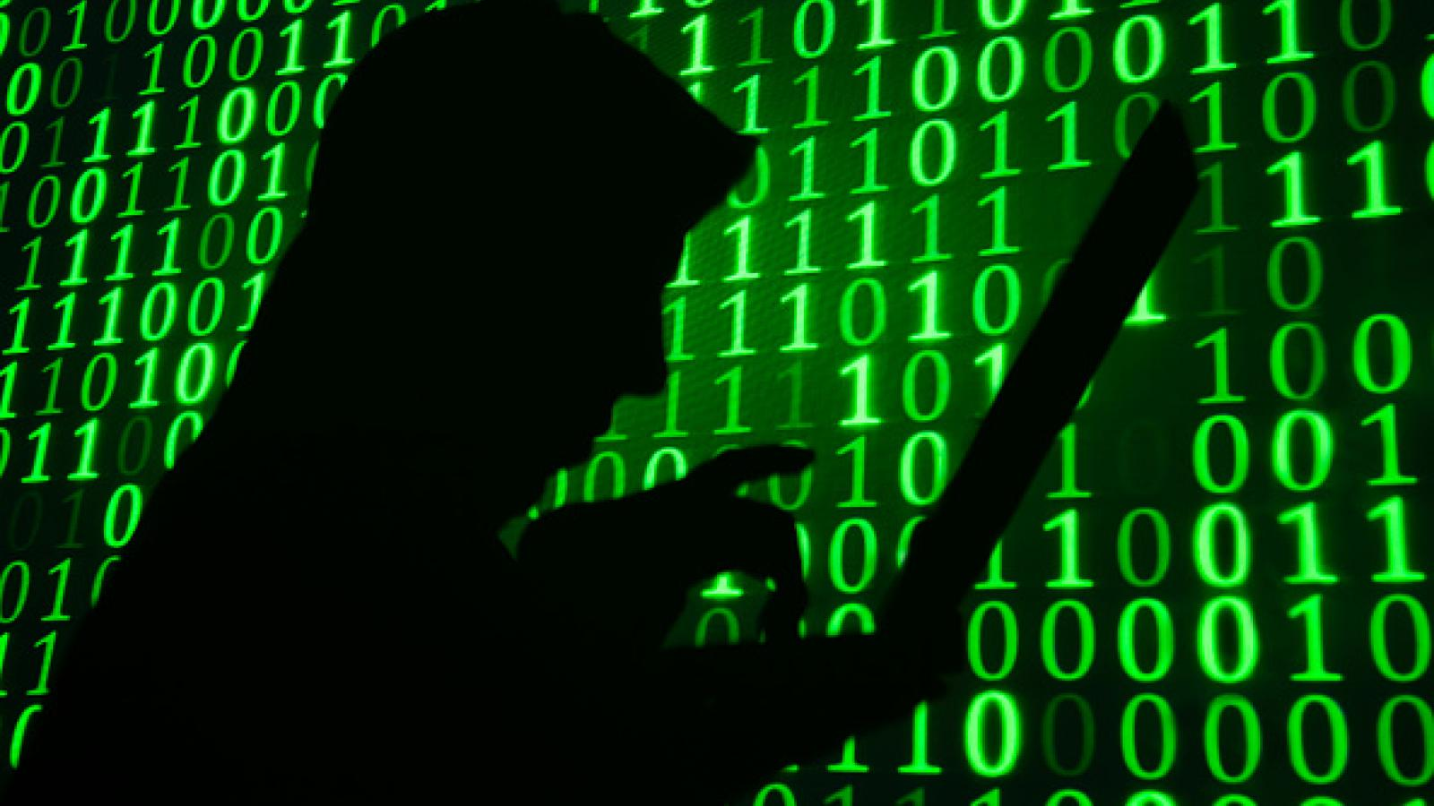 Silhouette of a computer hacker