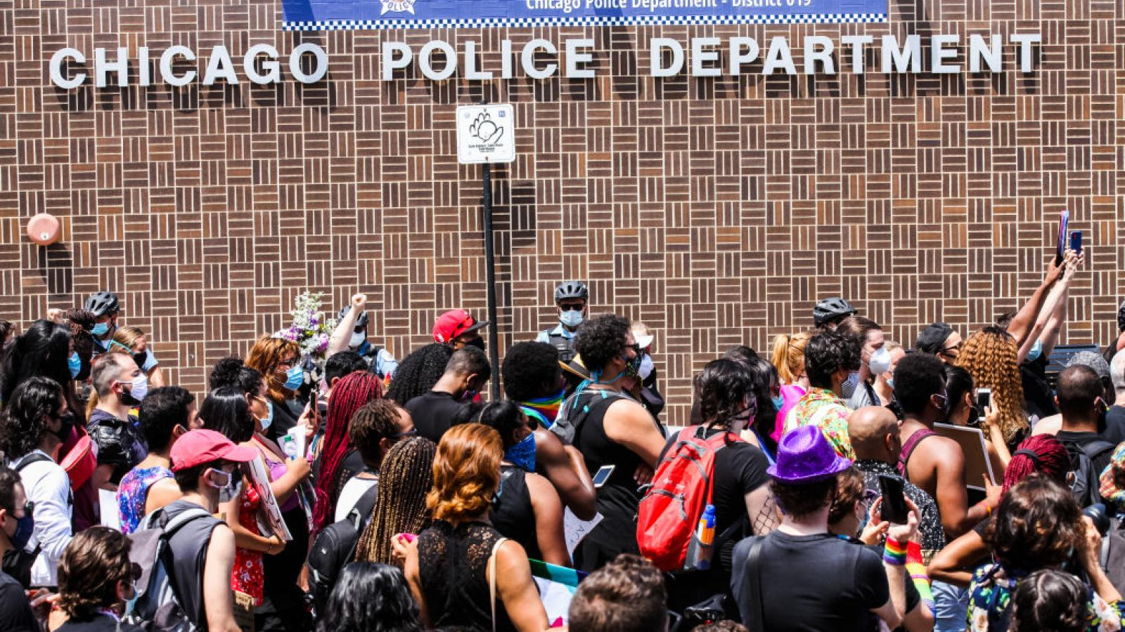 Chicagoans gather in front of a city Police Department