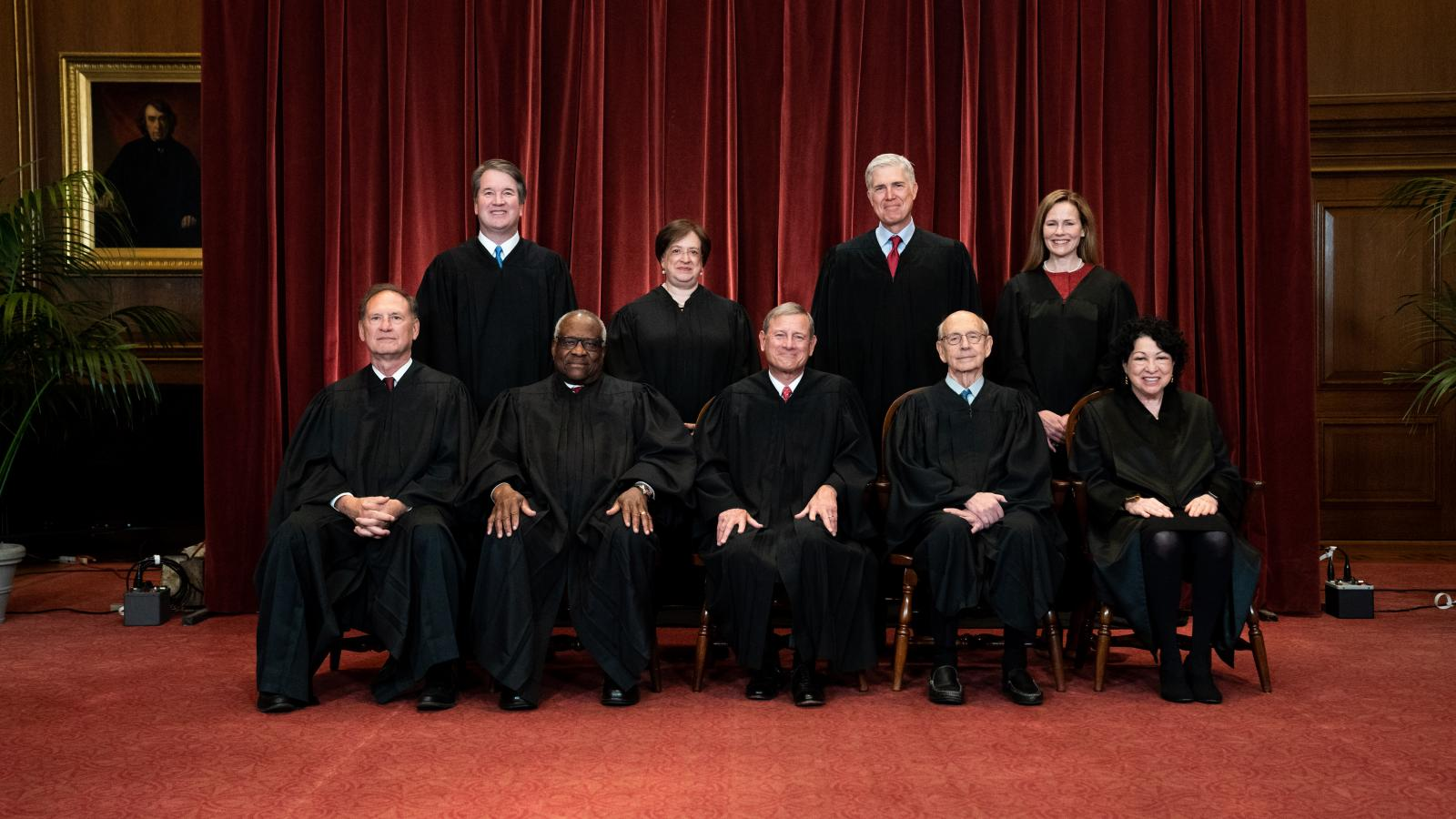 Members of the Supreme Court pose for a group photo at the Supreme Court in Washington, DC on April 23, 2021.