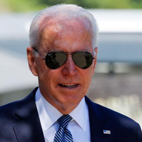 President Joe Biden wearing sun glasses.